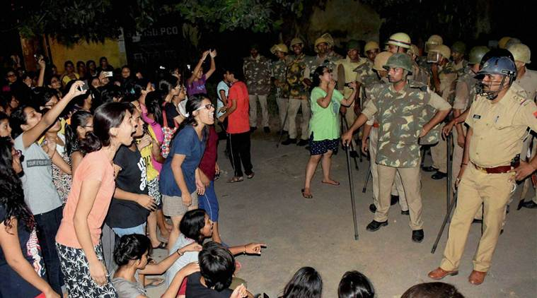Varanasi: Students and police in a standoff in Varanasi late Saturday night. Female students at the prestigious University were protesting against the administration's alleged victim-shaming after one of them reported an incident of molestation on Thursday. PTI Photo  (PTI9_24_2017_000107B)