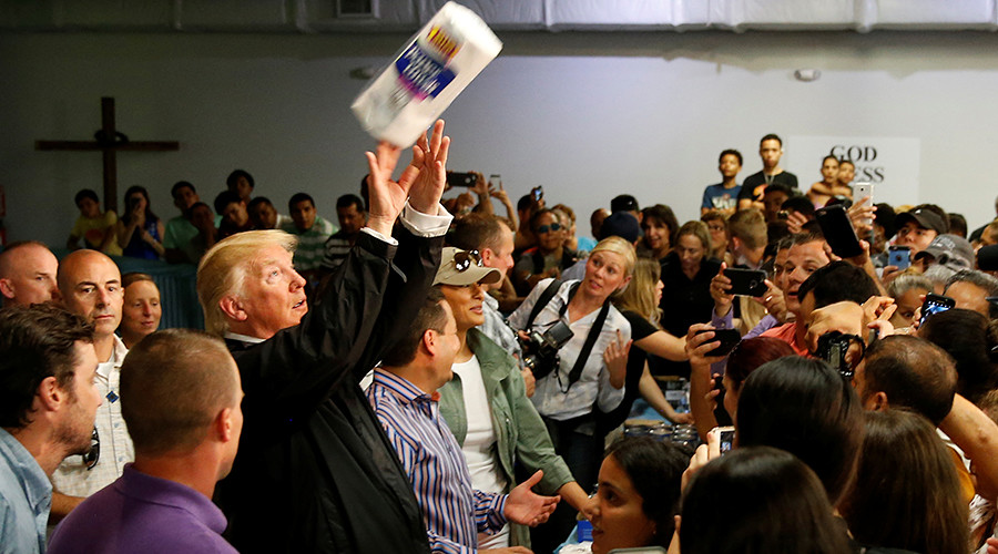 Trump throws paper towels into a crowd