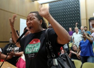 """Walker disrupts a City Council meeting on August 21, 2017 asking the Council, """"Why did you think you could do a business as usual after what happened [with Klan violence] on the 12th?"""""""