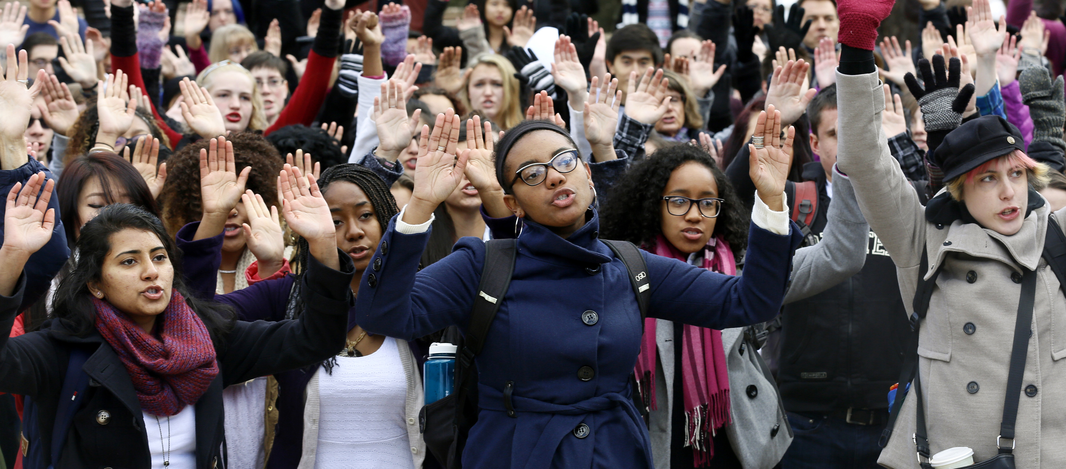 "Students at the University of Colorado chant ""Hands up, don't shoot"" as they hold up their hands for 4 1/2 minutes in support of protesters in Ferguson Missouri, during a demonstration, which was part of a national student walk-out, in Boulder, Colorado December 1, 2014.   REUTERS/Rick Wilking (UNITED STATES - Tags: EDUCATION CRIME LAW CIVIL UNREST) - RTR4GBFB"