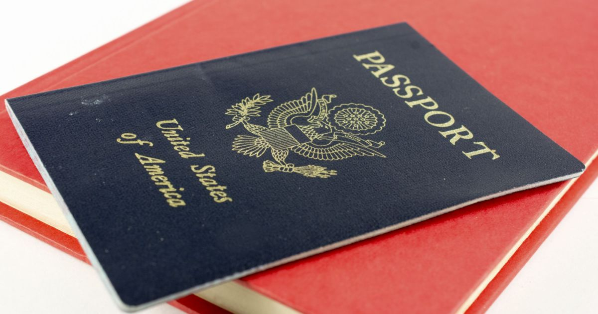 image of a united states passport on top of a closed red book